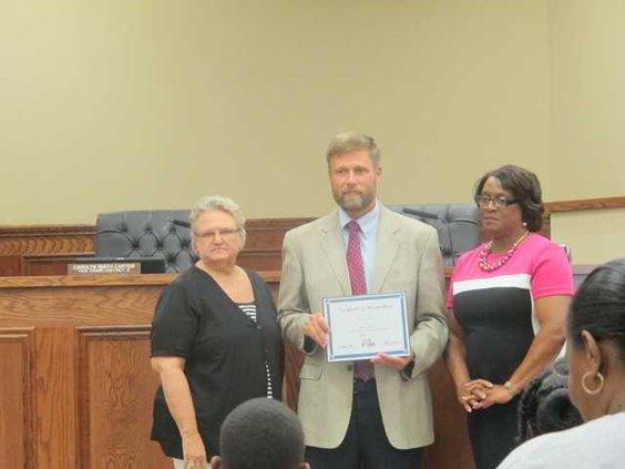 BI Principal Scott Carrier receiving award on behalf for BI
