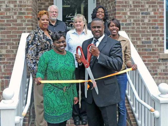 Ribbon cutting Team Clift