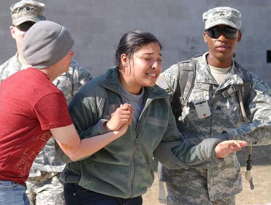 soldiers assist with crying civilian