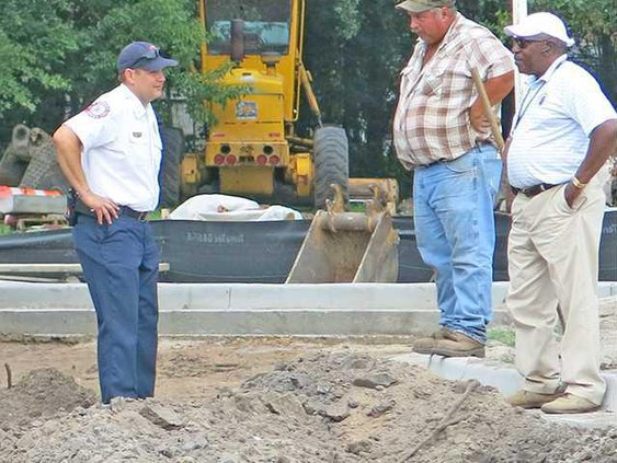 HFD Capt. Chris Moss with AD Williams Construction Company workers