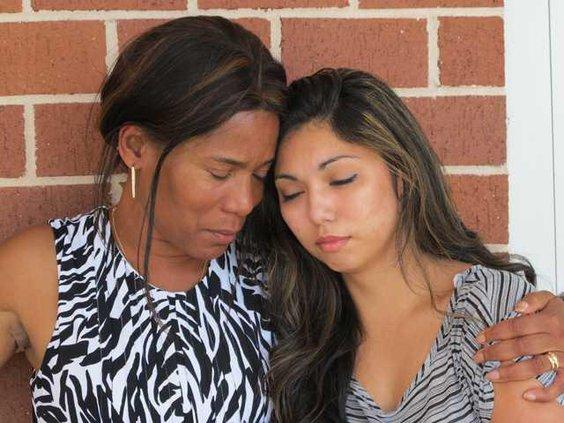 Ling-Noonan-comforting-Feylene-Carrillo
