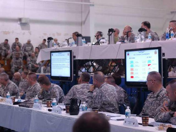 Members of 41st listen during drill