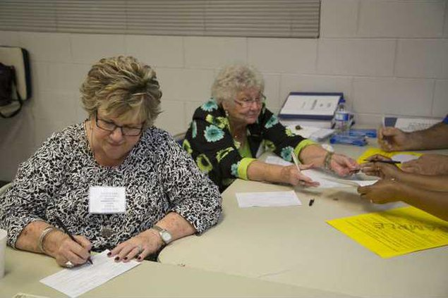Poll workers Barbara Fields and Retha Standard assist Hinesville voters at the Shuman Center Nov. 3 15. Caitlin Kenney