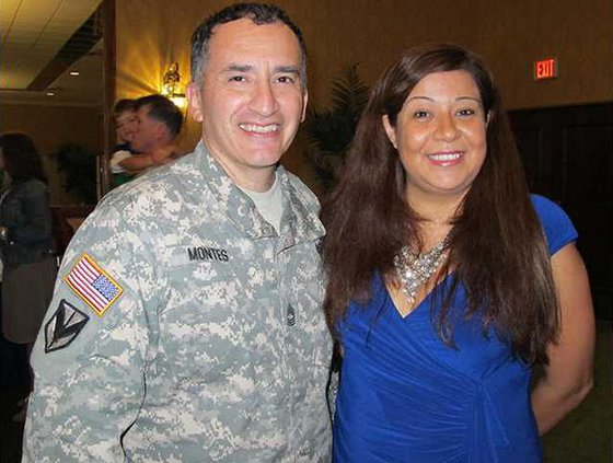 Volunteer Rubi Blancas with husband MSG Gabriel Montes