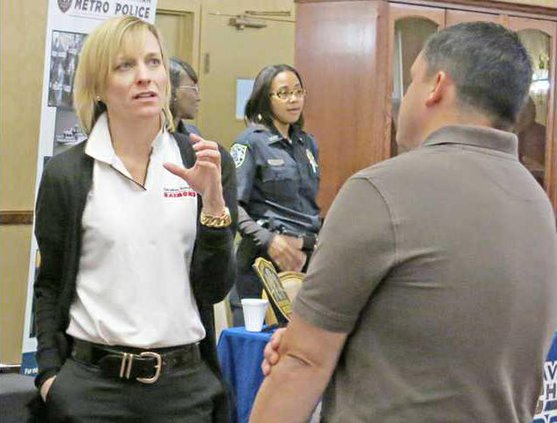 Caolina Handling employees talk to soldier