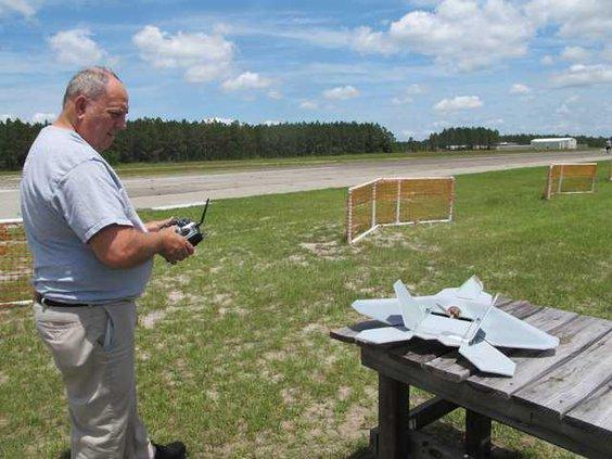 Club prez Lew Watdrop with model F-22
