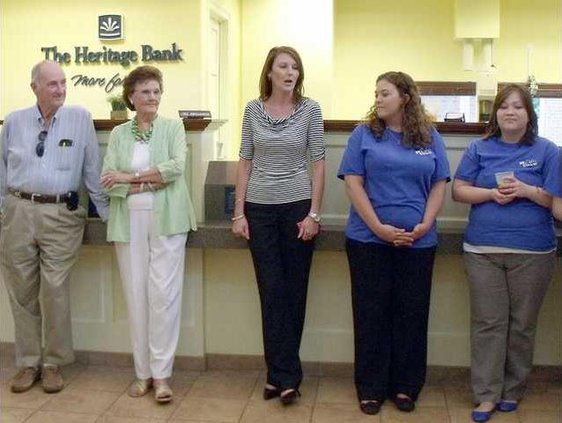 Melissa Deal speaks at the Heritage Bank Business After Hrs in Long Co