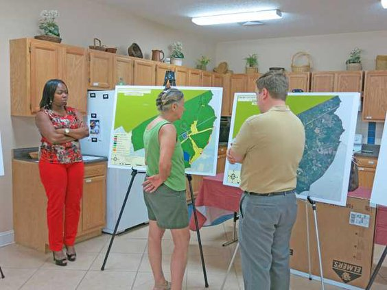 Nancy King looks at revised land use map with Jones and Patenaude