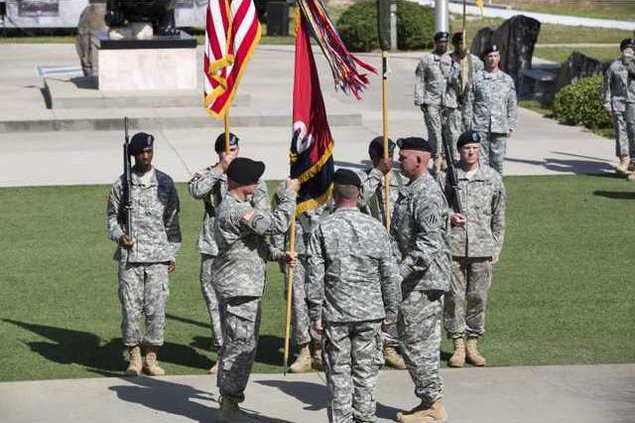 The 2nd Infantry Brigade Combat Team flag is unfurled during the reorganization ceremony in Marne Gardens on Fort Stewart May 18