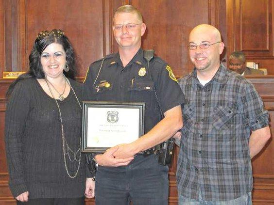 WEB Susan and Scott Baker with HPD Officer Jassen Garrett