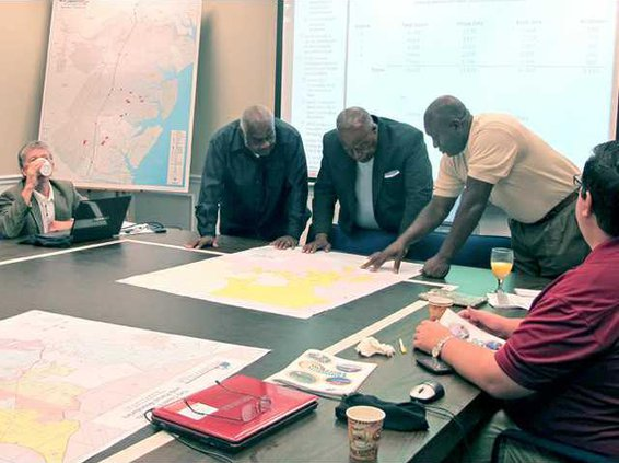 city leaders look at GIS map of proposed Westside annexation area for allocation to council districts