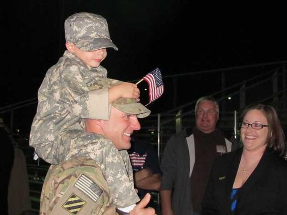 1Lt Justin Shaw with Tyler 4 and wife Sara