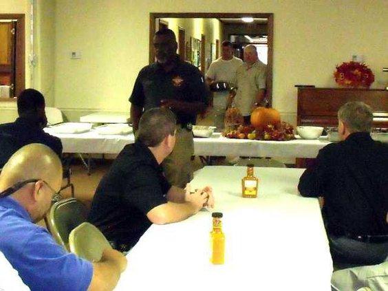 Chaplain Herman Scott speaks at luncheon