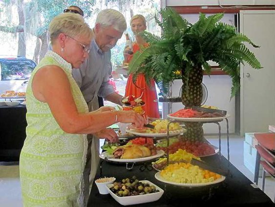 Guests partake in the dinner and desserts provided by Occassions Catering and Event Services