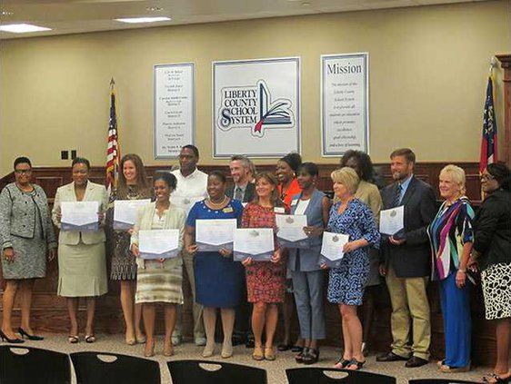 LCSS staff with accreditation certificates