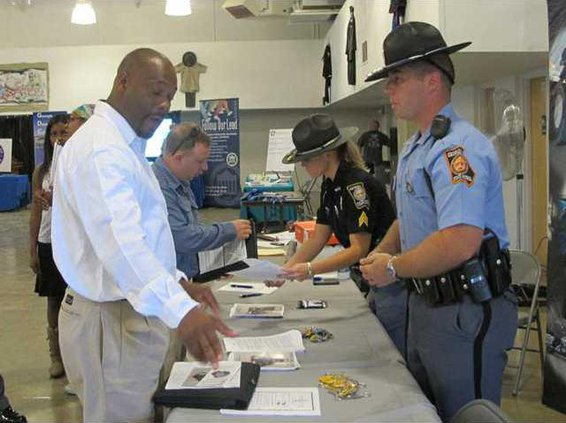 veterans asking questions at Dept. of Public Safety table