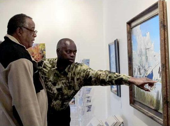 webTurner shows details in painting to Richard Mitchell