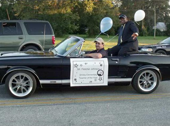 4---SES Teacher of the Year Fletcher Johnson waves to the crowd at the HC Parade.