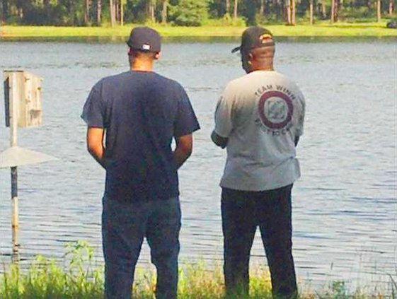 Donald Spencer DAV Chapter 46 senior vice chair right with WTB soldier fishing for the first time in his life
