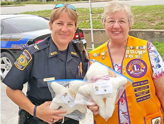 dolls to police