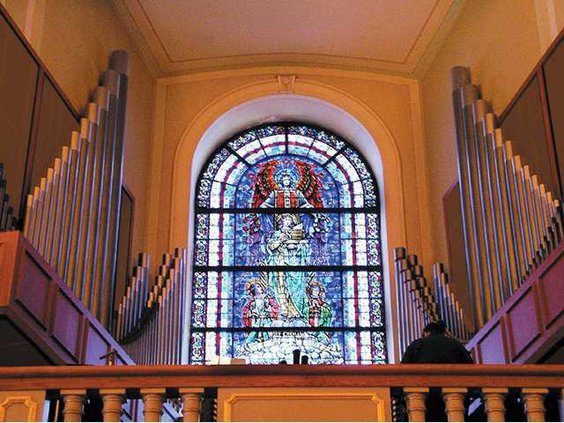 stained glass behind pulpit