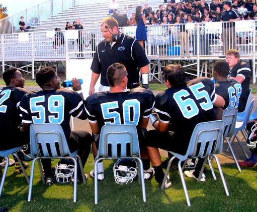 Picture-Coach McNair talking to Blue Tide Offensive Line