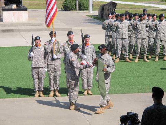 Lt Col Tia Benning and CSM Richard D Knott uncase the 63rd Expeditionary Signal Battalions flag