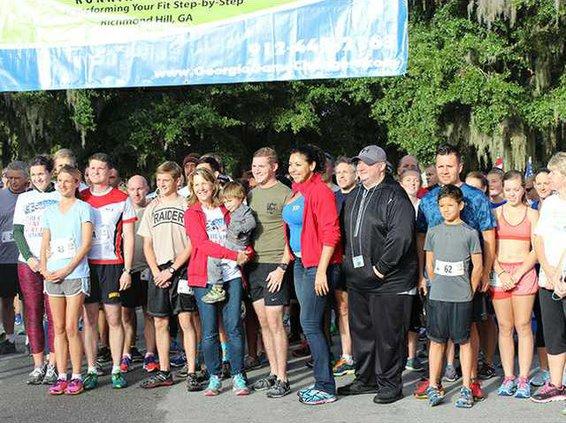Lisa Freeman smiles amongst the 5K runners before the race begins