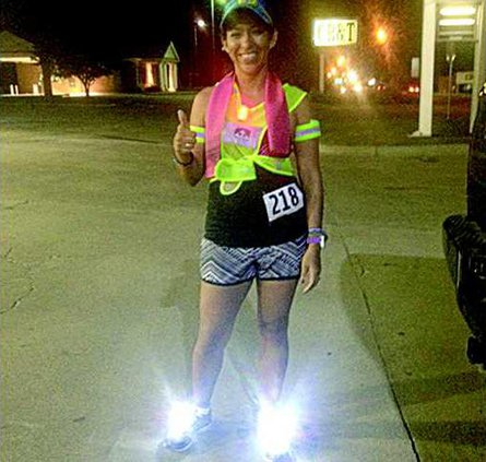 Sandra Reyes local runner gives a thumbs up on her night run