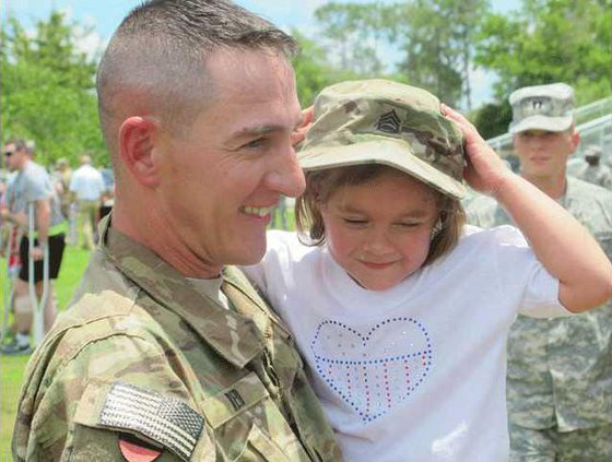 Sfc. Christopher Reed with Julia