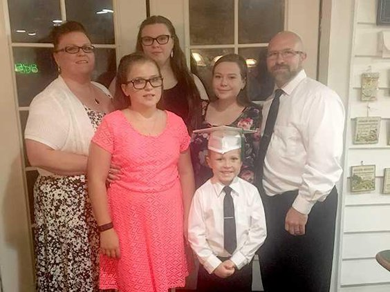 Amy and family pictured at son Noahs gradution from Richmond Hill Montessori. Photo provided