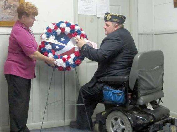 Schneider and Helmick placing wreath