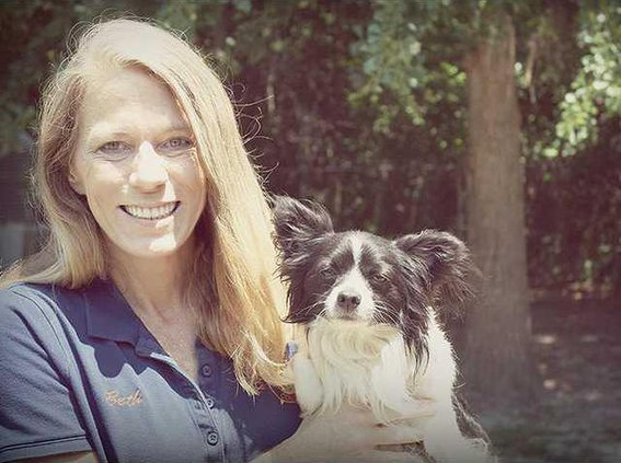 Beth Murray pictured with Sinbad at Animal Control in South Bryan. Photo by Evelyn Fallon