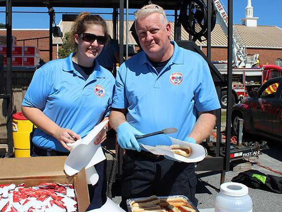 Heather Ward and Henry Lewis with Bryan County Emergency Services lend at hand at last years Bryan County Public Safety Day