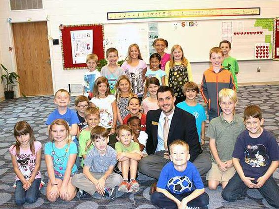 Miller takes a moment to pose with Ms. Kanickis 2nd Grade Class at MES. Photo by Evelyn Fallon