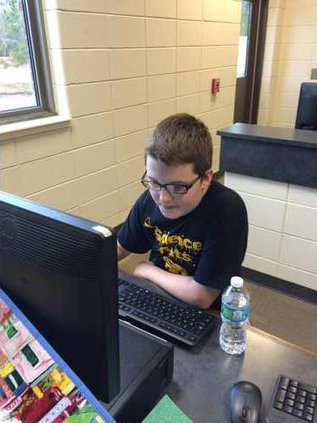 TJ Mazel 7th Grade RHMS Student researching at the computer for Science Olympiad. Photo provided