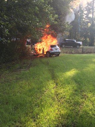 lewis burning car