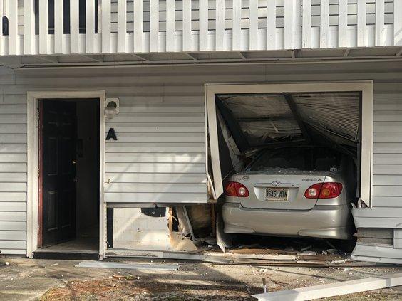 woman drives into home.jpeg