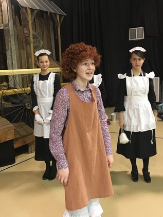 Hannah Sahr as Annie singing-I think I'm gonna like it here-with Cora McCullough & Rachel Gregory.jpg