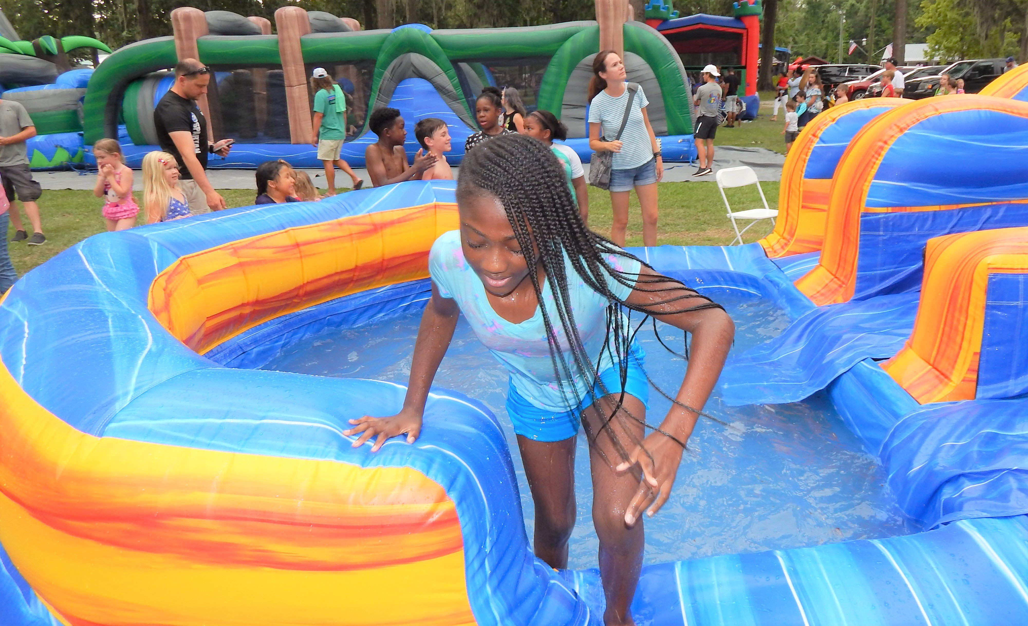 This young girl enjoyed the cool water at the bottom of the slide. Photo by Mark Swendra