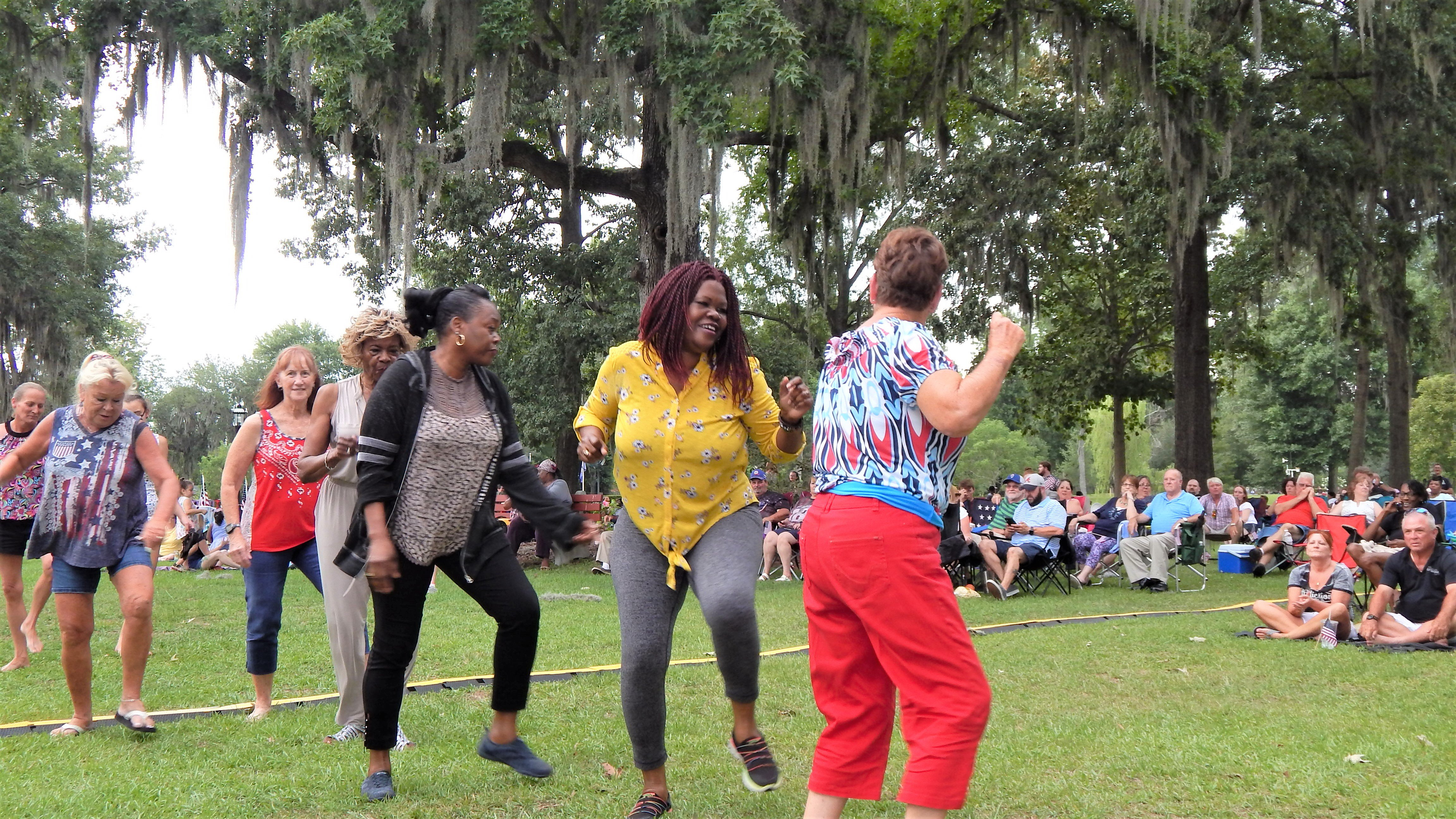 These ladies had a great time dancing to the music of the Tams and their backup band. Photo by Mark Swendra