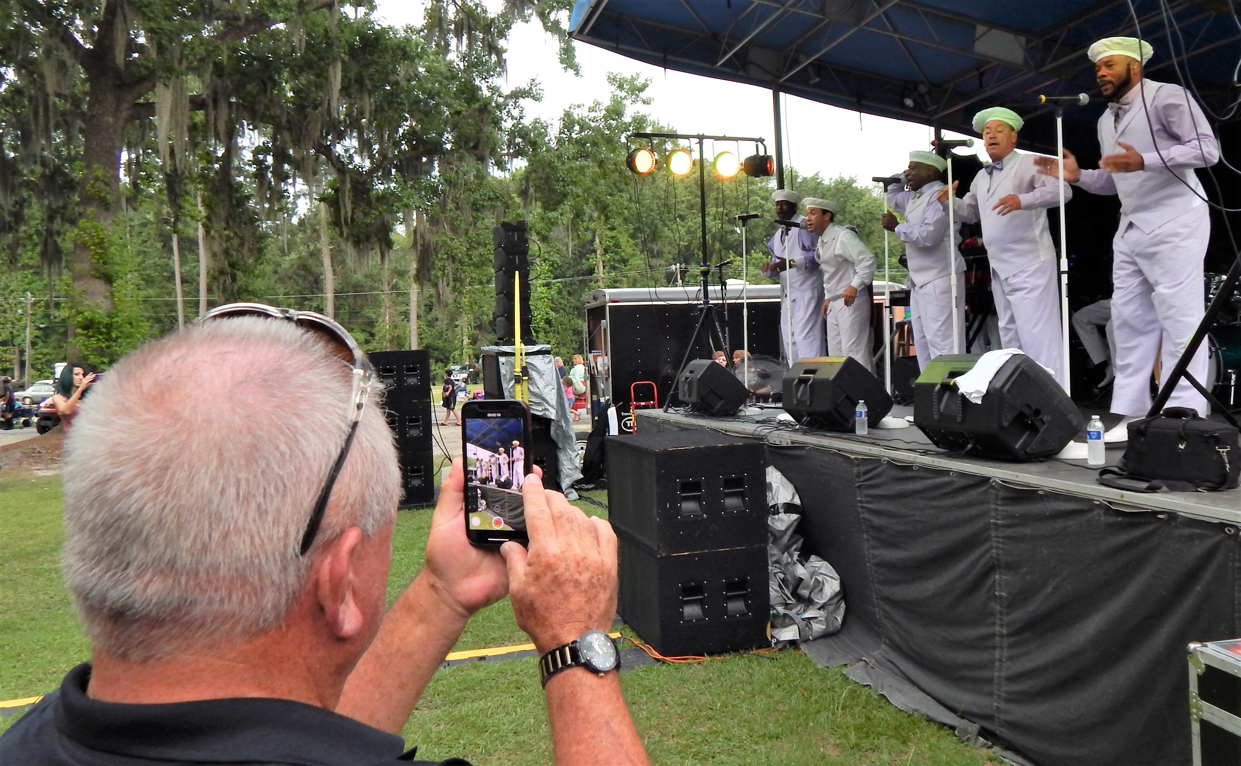 Several in the audience captured photos and videos of the Tams onstage. Photo by Mark Swendra