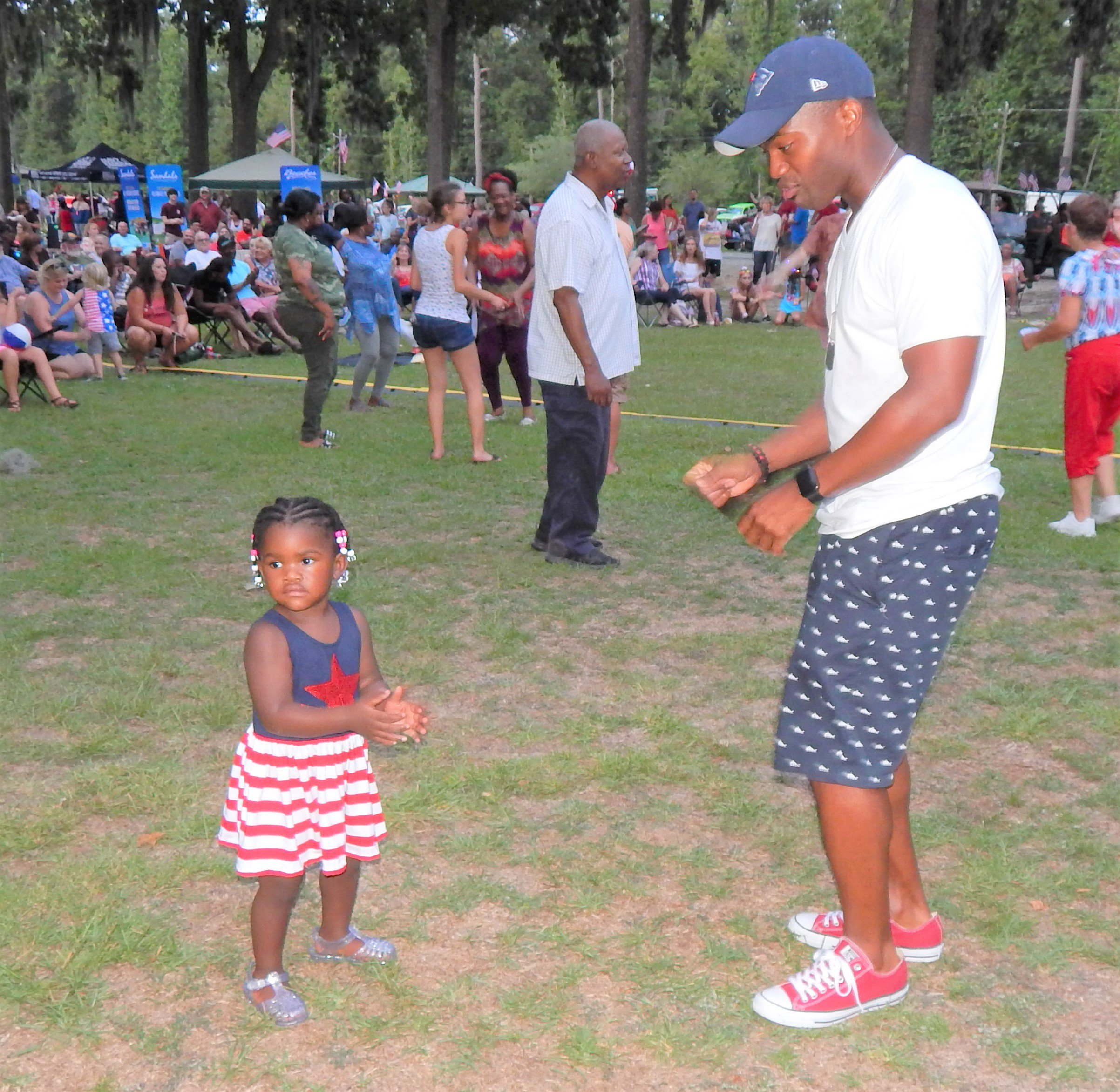 This father and daughter were among those who got up and danced. Photo by Mark Swendra