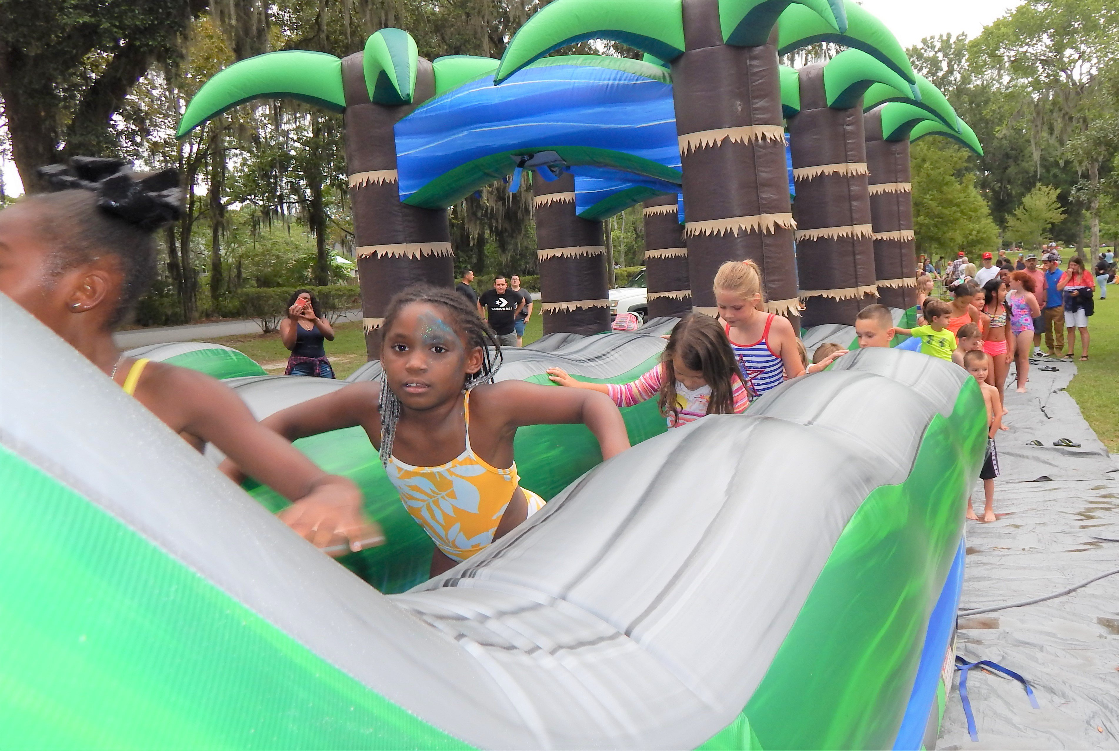 Kids enjoyed the water slides on this warm day. Photo by Mark Swendra.
