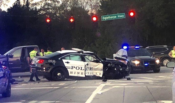 Officer hit red light running