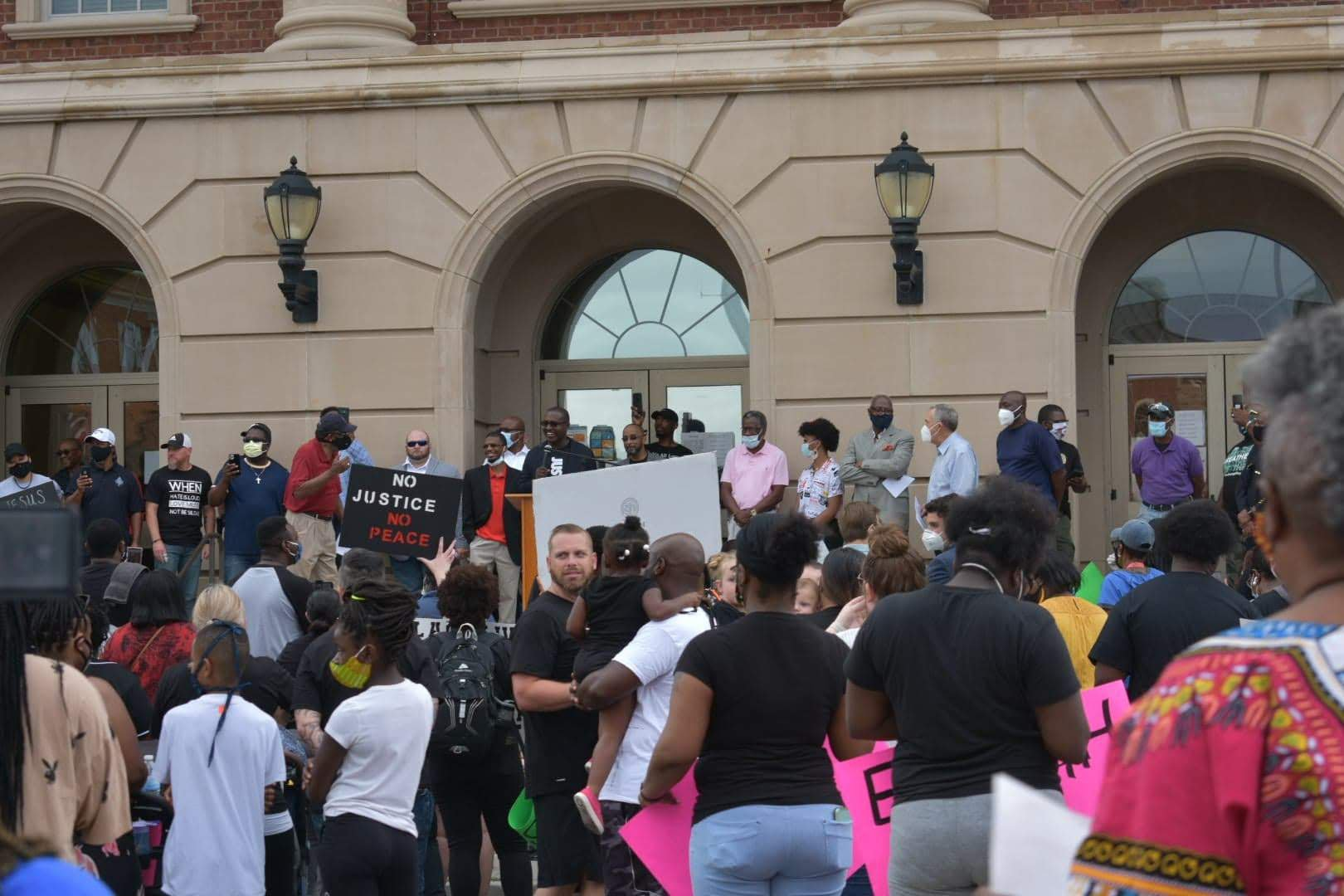crowd gathers at Justice Center