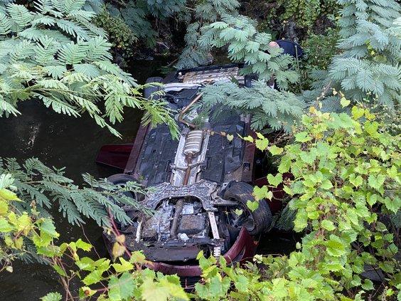 car in creek