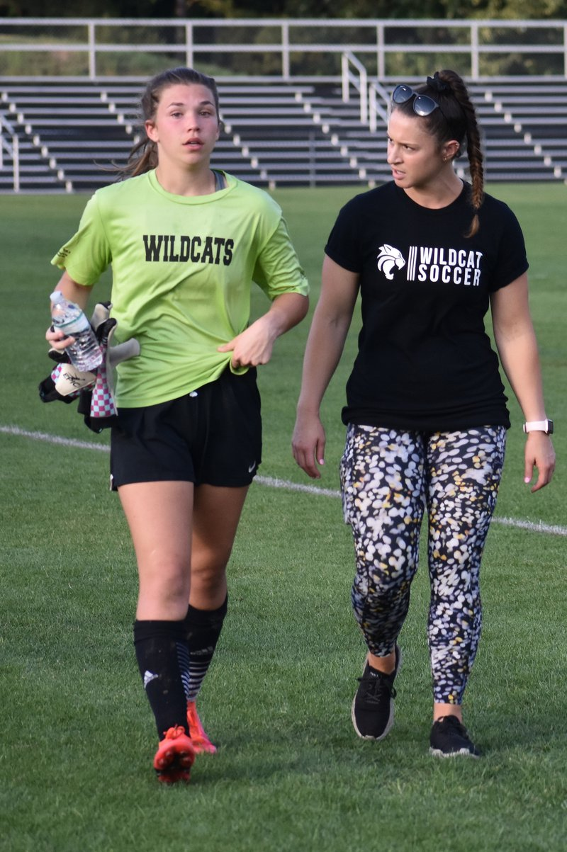 Goalie Olivia Galloway (L), Coach Dorothy Biron discuss things at halftime break