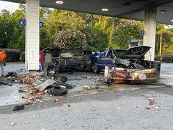car plows into gas pump