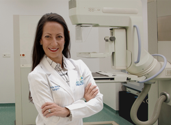 Dr. Jillard with a mammography unit.
